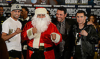 Dec 12,2012. Los Angeles CA. USA.. (L-R) Amir Khan, Golden Boy Santa, Oscar De Lay Hoya and Carlos Molina pose together during a Los Angeles press conference. The fight will be scene on ShowTime live from the Los Angeles Sports Arena Saturday  Dec 10th.  Photo by Gene Blevins/LA Daily News