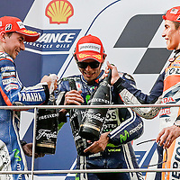 MotoGP race winner, Spanish Marc Marquez (R) of Repsol Honda Team toast his champagne with second placed Italian MotoGP rider Valentino Rossi (C) of Movistar Yamaha MotoGP and third Spanish Jorge Lorenzo (L) of Movistar Yamaha MotoGP during the podium ceremony for 2014 Malaysian Motorcycling Grand Prix in Sepang International Circuit near  Kuala Lumpur, Malaysia, 26 October 2014. Marquez winning in 2014 MotoGP Malaysia is the 12th wins of this season, equalling the record held by Mick Doohan.