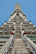 The central prang, a Khmer-style tower at Wat Arun, a Buddhist temple also known as the Temple of Dawn, in Bangkok, Thailand.