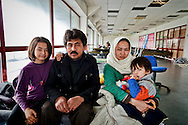 Rasoi Hasani 35 years old  with his wife and children comes from Malistan is a district in the west of Ghazni Province, Afghanistan, he fled for fear of the Taliban arrived in Iran and now headed to Austria to reunite with relatives,  guest  of the Temporary accommodation center for immigrants in Athens, at Olimpico hockey in the area Elliniko 10 Febraury 2016.<br />