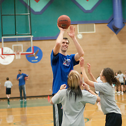 RENO, NV - JANUARY 10:  Images from the NBA D-League Showcase FIT Clinic at Billinghurst Middle School in Reno, Nev., Tuesday, Jan. 10, 2012. The basketball skills clinic featured players from the Idaho Stampede and Los Angeles Defenders as well as D-League President Dan Reed.