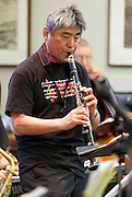 Band leader Larry Nobori performs with the Minidoka Swing Band in the US Bank Room of Multnomah County Library - Central branch, Portland, Oregon. The performance was in conjunction with Portland Center Stage's production of Snow Falling on Cedars, by David Guterson.