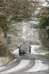 © Licensed to London News Pictures. 09/11/2019. New Radnor, Powys, Wales, UK. A motorist negotiates hazardous conditions on the A481 between Hundred House and New Radnor in Powys, Wales, UK. After a cold night with temperatures dropping to below zero degrees C and a frosty early morning start to the day, snow falls on some high land in Powys and the valleys get some heavy rainfall during the morning. UK.Photo credit: Graham M. Lawrence/LNP