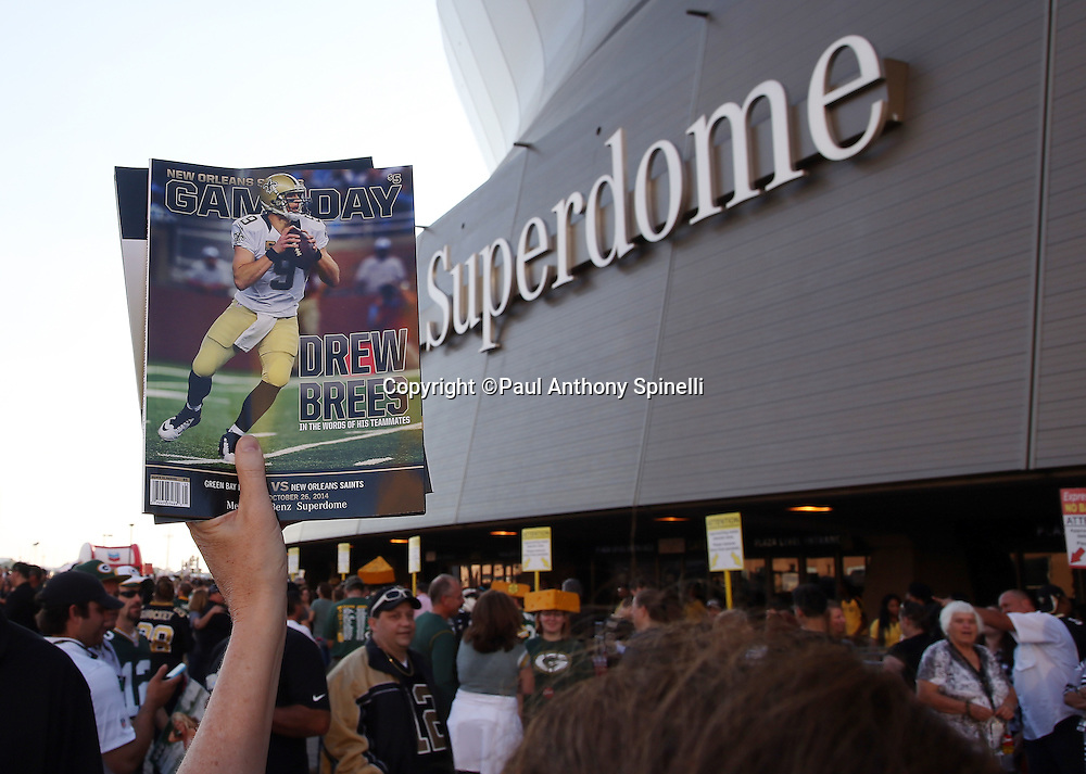 A vendor sells GameDay programs in front of the Mercedes-Benz Superdome before the New Orleans Saints NFL week 8 regular season football game against the Green Bay Packers on Sunday, Oct. 26, 2014 in New Orleans. ©Paul Anthony Spinelli