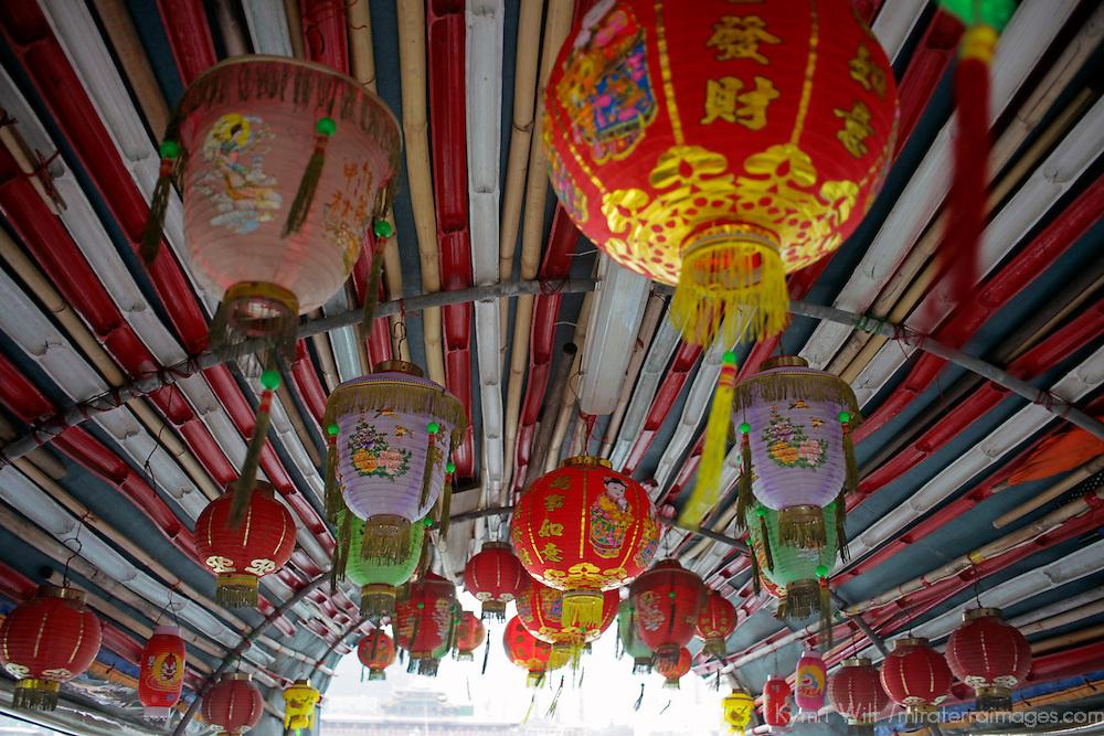 Asia, China, Hong Kong. Paper lanterns hang from traditional sampan in Aberdeen Harbour.