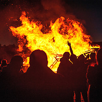 100214  Adron Gardner/Independent<br /> <br /> Tendrils of the Patriot homecoming bonfire reach for the sky at Miyamura High School in Gallup Thursday.