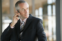 Businessman Using mobile phone.