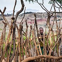 A young girl watches her neighbors while they dance near Konso, Ethiopia