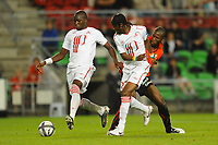 FOOTBALL - FRENCH CHAMPIONSHIP 2010/2011 - L1 - STADE RENNAIS v LILLE OSC - 07/08/2010 - PHOTO PASCAL ALLEE / DPPI - MOUSSA SOW AND GERVINO (LILLE) / ROD FANNI (RENNES)