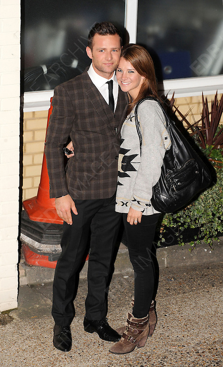 14.OCTOBER.2012. LONDON<br /> <br /> HARRY JUDD AND FIANCE IZZY JOHNSTON LEAVING THE X-FACTOR STUDIOS AFTER THE RESULTS SHOW.<br /> <br /> BYLINE: EDBIMAGEARCHIVE.CO.UK<br /> <br /> *THIS IMAGE IS STRICTLY FOR UK NEWSPAPERS AND MAGAZINES ONLY*<br /> *FOR WORLD WIDE SALES AND WEB USE PLEASE CONTACT EDBIMAGEARCHIVE - 0208 954 5968*