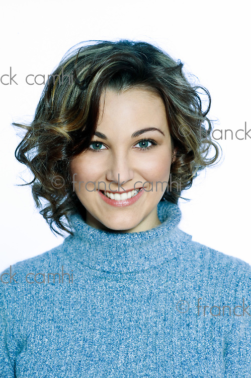 studio shot portrait of a young caucasian and cute woman toothy smiling brunette on isolated white background
