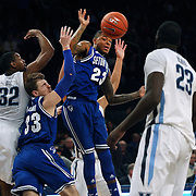 Seton Hall players Patrik Auda, (thirty-three) and Fuquan Edwin, (center), combine to tip away the ball during the Villanova Wildcats Vs Seton Hall Pirates basketball game during the Big East Conference Tournament at Madison Square Garden, New York, USA. 12th March 2014. Photo Tim Clayton