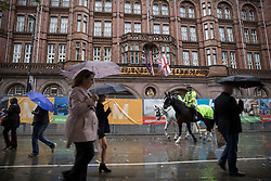 © Licensed to London News Pictures . 30/09/2017. Manchester, UK. People , police and security outside the secured Midland Hotel as Manchester prepares for the Conservative Party Conference , which is taking place inside a secured zone around the Manchester Central Convention Centre . Photo credit: Joel Goodman/LNP