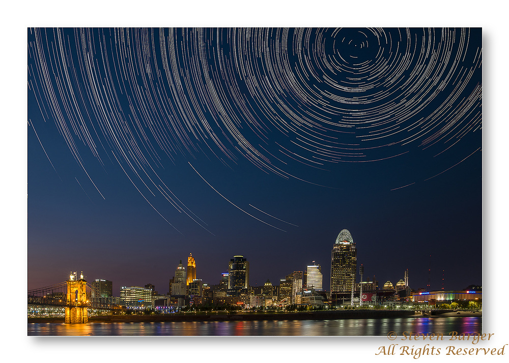 Two hundred sixty seven images used to create this star trail image over Cincinnati. Image taken from Riverside Drive in Covington Kentucky