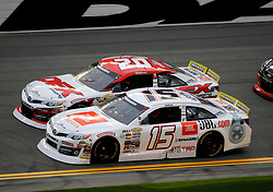 February 9, 2019 - Daytona, FL, U.S. - DAYTONA, FL - FEBRUARY 09: Harrison Burton (20) DEX Imaging Toyota, Christian Eckes (15) JBL Audio Toyota during the running of the Lucas Oil 200 on February 9, 2019 at Daytona International Speedway in Daytona Beach, Florida (Photo by Jeff Robinson/Icon Sportswire) (Credit Image: © Jeff Robinson/Icon SMI via ZUMA Press)