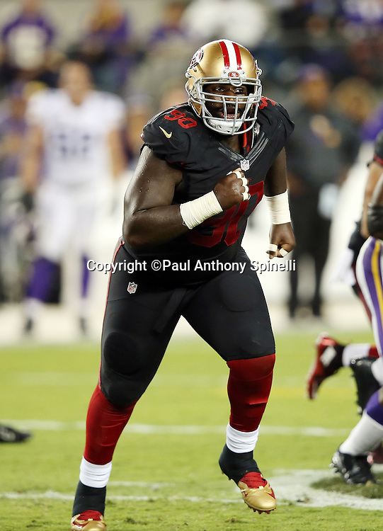 San Francisco 49ers nose tackle Glenn Dorsey (90) chases the action during the 2015 NFL week 1 regular season football game against the Minnesota Vikings on Monday, Sept. 14, 2015 in Santa Clara, Calif. The 49ers won the game 20-3. (©Paul Anthony Spinelli)