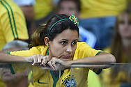 A dejected fan of Brazil during the 2014 FIFA World Cup match at Mineir&atilde;o, Belo Horizonte<br /> Picture by Stefano Gnech/Focus Images Ltd +39 333 1641678<br /> 08/07/2014