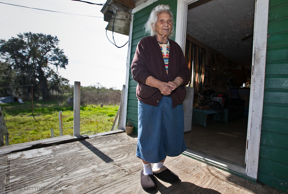 Oxcelia Dardar Naquin on the front porch of her home on the Isle de Jean Charles, in Louisana.