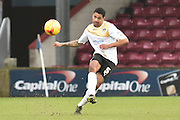 Alex Wynter of colchester United kicks forward  during the Sky Bet League 1 match between Scunthorpe United and Colchester United at Glanford Park, Scunthorpe, England on 23 January 2016. Photo by Ian Lyall.