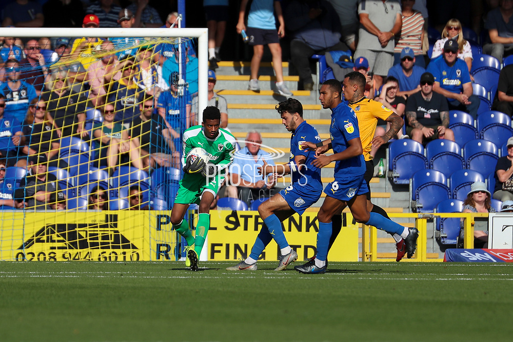 AFC Wimbledon goalkeeper Nathan Trott (1) making save during the EFL Sky Bet League 1 match between AFC Wimbledon and Bristol Rovers at the Cherry Red Records Stadium, Kingston, England on 21 September 2019.
