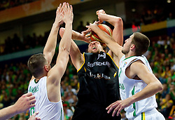 Dirk Nowitzki of Germany between Paulius Jankunas of Lithuania and Jonas Valanciunas of Lithuania during basketball game between National basketball teams of Lithuania and Germany at FIBA Europe Eurobasket Lithuania 2011, on September 11, 2011, in Siemens Arena,  Vilnius, Lithuania. Lithuania defeaed Germany 84-75. (Photo by Vid Ponikvar / Sportida)