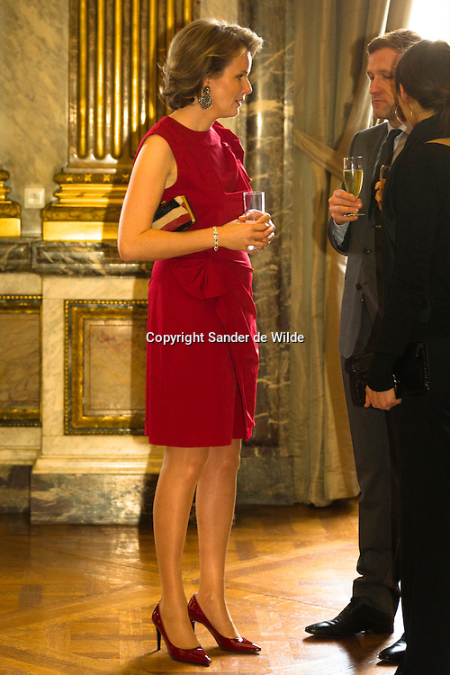 The Belgian Royal family gave a newyears drink in the palace for all ambassadors. In this picture: Princess Mathilde with Paul Mangette, a politician.2012-01-12, Brussels, Belgium.