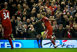 LIVERPOOL, ENGLAND - Tuesday, March 13, 2012: Liverpool's captain Steven Gerrard celebrates scoring the first of his hat-trick of goals against Everton on his 400th Premier Leagie appearance during the Premiership match at Anfield. Liverpool won 3-0 and Gerrard became the first player since Ian Rush in 1982 to score a hat-trick in a Merseyside Derby. (Pic by David Rawcliffe/Propaganda)