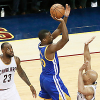 10 June 2016: Golden State Warriors forward Harrison Barnes (40) takes a jump shot over Cleveland Cavaliers forward Richard Jefferson (24) past Cleveland Cavaliers forward LeBron James (23) during the Golden State Warriors 108-97 victory over the Cleveland Cavaliers, during Game Four of the 2016 NBA Finals at the Quicken Loans Arena, Cleveland, Ohio, USA.