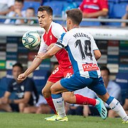 BARCELONA, SPAIN - August 18:  Sergio Reguilon #23 of Sevilla defended by Oscar Melendo #14 of Espanyol during the Espanyol V  Sevilla FC, La Liga regular season match at RCDE Stadium on August 18th 2019 in Barcelona, Spain. (Photo by Tim Clayton/Corbis via Getty Images)