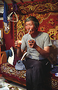 photos from travels in Mongolia - lighting cigarett<br /> <br /> <br /> Photo must be credited to &quot;Jacques-Jean Tiziou / www.jjtiziou.net&quot; adjacent to the image. Online credits should link to www.jjtiziou.net. Photo may only be used as permitted by the photographer.