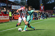 Sean Long and Jack Iredale   during the EFL Sky Bet League 2 match between Cheltenham Town and Carlisle United at Jonny Rocks Stadium, Cheltenham, England on 20 August 2019.