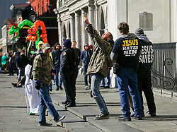 09 February 2016. New Orleans, Louisiana.<br /> Mardi Gras Day. A man takes umbrage at the messages of hate spewing forth from rude and obnoxious fundamentalist Christians at St Louis Cathedral in the French Quarter. <br /> Photo©; Charlie Varley/varleypix.com