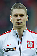 Poland's Lukasz Piszczek before international friendly soccer match between Poland and Scotland at National Stadium in Warsaw on March 5, 2014.<br /> <br /> Poland, Warsaw, March 5, 2014<br /> <br /> Picture also available in RAW (NEF) or TIFF format on special request.<br /> <br /> For editorial use only. Any commercial or promotional use requires permission.<br /> <br /> Mandatory credit:<br /> Photo by &copy; Adam Nurkiewicz / Mediasport