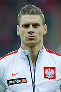 Poland's Lukasz Piszczek before international friendly soccer match between Poland and Scotland at National Stadium in Warsaw on March 5, 2014.<br /> <br /> Poland, Warsaw, March 5, 2014<br /> <br /> Picture also available in RAW (NEF) or TIFF format on special request.<br /> <br /> For editorial use only. Any commercial or promotional use requires permission.<br /> <br /> Mandatory credit:<br /> Photo by © Adam Nurkiewicz / Mediasport