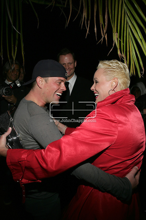 9th February 2009, Beverly Hills, California. Actress Brigitte Nielsen with Claus Hjelmbak at Bondi Blonde's Style Mansion International Party, which was hosted by singer Katy Perry. PHOTO © JOHN CHAPPLE / REBEL IMAGES.tel: +1-310-570-910