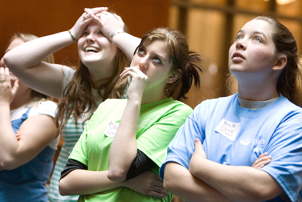 Annie Holbert (from left), Shonata Lenigar,and Kayla Cline anxiously watch their team's egg drop during the Russ College of Engineering and Technology research fair/engineering day in the Baker Center ballroom on Thursday, 5/3/07.