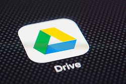 Google Drive online cloud storage service app close up on iPhone smart phone screen