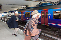 Shakespearean Actors in the form of Tonderai Mumyevu (white hat) and Denton Chikura (brown hat) from Two Gents Productions meet Rapper Rob Broderick and guitarist James Hancox to welcome new passengers to the Souh Station at Blackfriars in London, England.