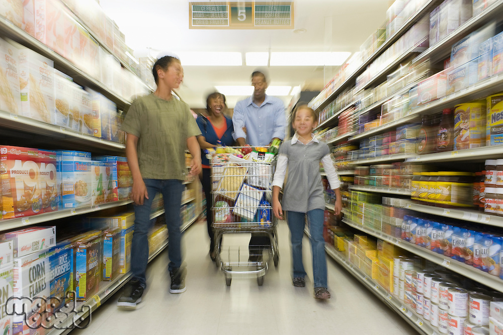Family of four shopping in supermarket