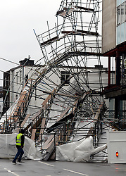 © Licensed to London News Pictures. 29/04/2012. London, UK . Heavy winds have caused a large section of scaffolding to collapse on building work being carried out for a new Jamie Oliver restaurant on Notting Hill Gate in West London today 29th April 2012. The structure came down at approx 0300am across a main road junction and nobody was hurt. The  Photo credit : Stephen Simpson/LNP