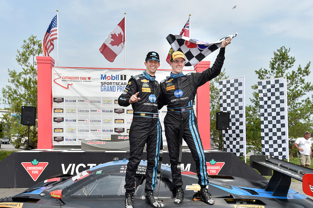 10-12 July 2015, Bowmanville, Ontario Canada<br /> 10, Chevrolet, Corvette DP, P, Ricky Taylor, Jordan Taylor celebrate the win in victory lane<br /> &copy;2015 Scott R LePage <br /> LAT Photo USA