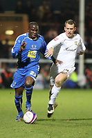 Photo: Pete Lorence/Sportsbeat Images.<br />Peterborough United v Milton Keynes Dons. Coca Cola League 2. 15/12/2007.<br />Claude Gnakpa charges ahead of Aaron Wilbraham.