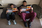 Nasir Williams, left, and Reyshaun Okafor read during Kesha James' class at Dr. Louis A. Cerulli School No. 34 in Rochester, New York on Tuesday, February 23, 2016. The district is in the early stages of a planned 1:1 device to student program.