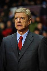 Arsenal Manager Arsene Wenger (FRA) stands in the dugout before the match - Photo mandatory by-line: Rogan Thomson/JMP - Tel: Mobile: 07966 386802 - 13/01/2014 - SPORT - FOOTBALL - Villa Park, Birmingham - Aston Villa v Arsenal  - Barclays Premier League.