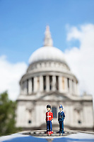 Figurines of London officers with St. Paul's Cathedral in background