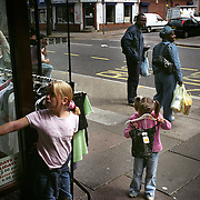 Girls stand by a shop in Leicester city. ..Leicester is expected to be the first city in the UK to have a majority non-white population within the next few years. It is one of the most ethnically-diverse cities in Europe. ..
