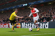 Alexis Sanchez of Arsenal takes on Lukasz Piszczek of Borussia Dortmund during the UEFA Champions League match at the Emirates Stadium, London<br /> Picture by Richard Calver/Focus Images Ltd +447792 981244<br /> 26/11/2014