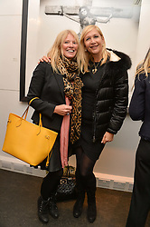 Left to right, KELLY COOPER and TANIA BRYER at a private view of photographs 'Terry O'Neill-The Best Of' held at The Little Black Gallery, 13A Park Walk, London on 16th January 2014.