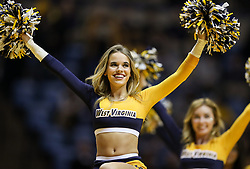 Feb 12, 2018; Morgantown, WV, USA; A West Virginia Mountaineers cheerleader performs during the first half against the TCU Horned Frogs at WVU Coliseum. Mandatory Credit: Ben Queen-USA TODAY Sports