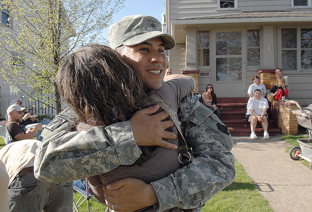 April 29, 2007  Jason Miller Dante Aponte of Lorain hugs his niece Samantha Brown on Sunday, April 29, 2007. Aponte, a Sgt. with the 18th Airborn betalion, renurned from Iraq to Indiana on April 23 and then returned home to his family on the 2200 block of East 33rd Street in Lorain on Sunday, April 29, 2007. Aponte said being home still feels a bit sureal but the best thing about being home is seeing his family and knowing he doesn't have to go back. Aponte has finished eight years with the military. Aponte was greeted by his family and neighbors with party BBQ and many heart felt greetings.